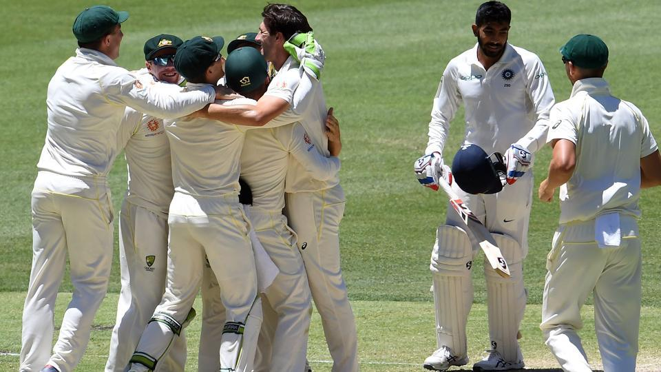 Australian players celebrate their victory as India's last batsman Jasprit Bumrah (2nd R) walks off the field during the day five of the second Test cricket match between Australia and India in Perth. (AFP)