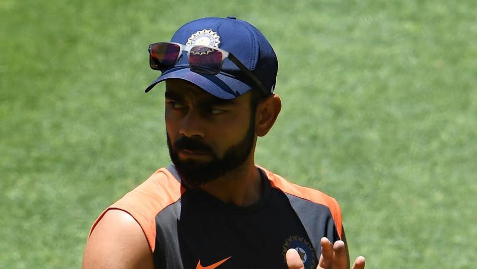 India's captain Virat Kohli claps for his teammates at the end of the second Test cricket match between Australia and India in Perth on December 18, 2018