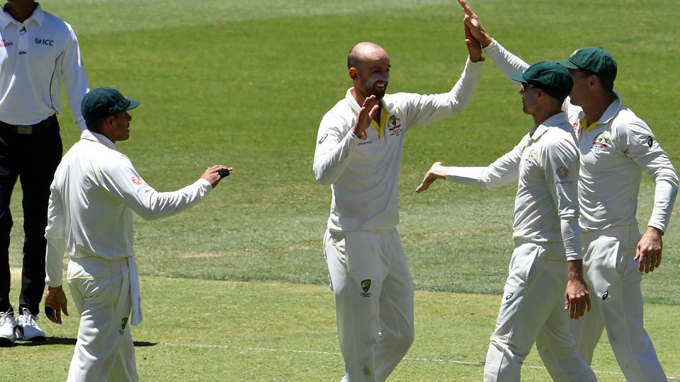 Australia's bowler Nathan Lyon (C) celebrates with teammates after dismissing India's batsman Rishabh Pant during day five of the second Test cricket match between Australia and India in Perth. (AFP)