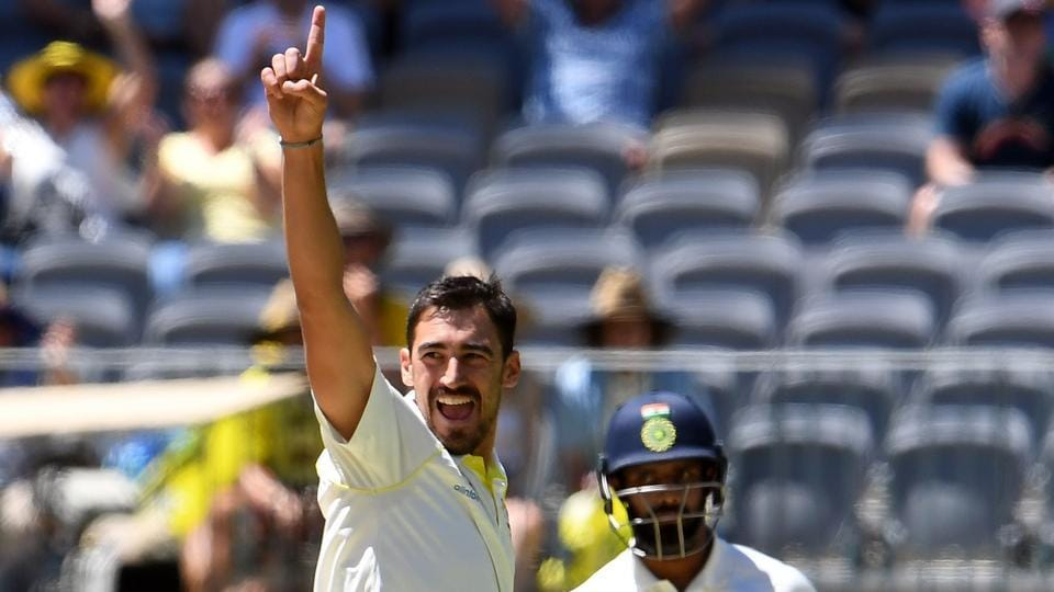 Australia's paceman Mitchell Starc (L) celebrates the dismissal of India's batsman Hanuma Vihari (R) during day five of the second Test cricket match between Australia and India in Perth. (AFP)