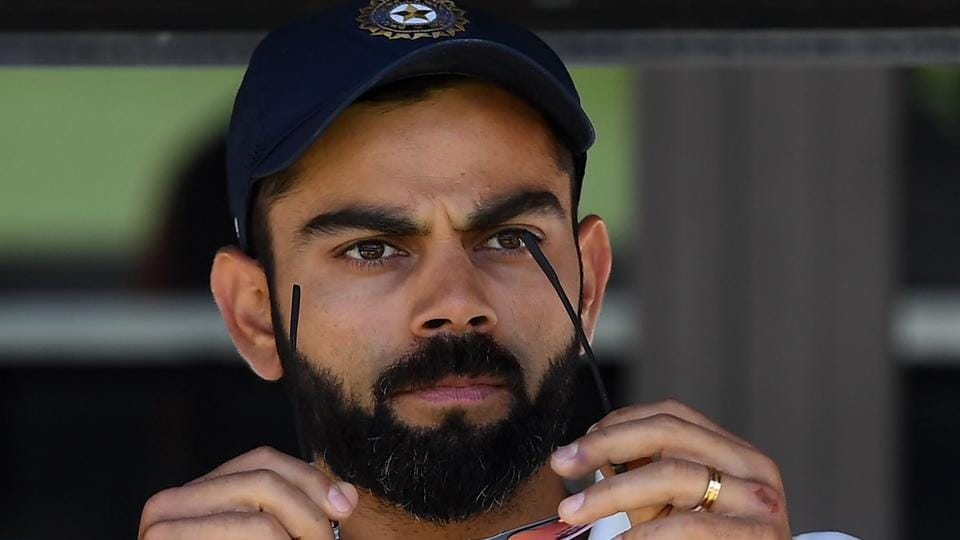 India's captain Virat Kohli (C) sits on the players bench at the end of second Test cricket match between Australia and India in Perth.