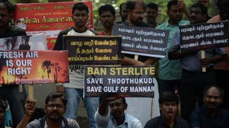Indian residents along with their children hold placards and shout slogan demanding to shutdown a copper smelter company 'Sterlite' at Thoothukudi in Chennai on April 01, 2018.