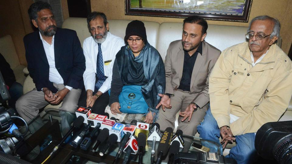 Fauzia Ansari (C) along with her husband Nehal Ansari (2R) and elder son Dr Khalid Ansari (2L), speaks to the media ahead of the deportation of  her son Hamid Ansari from Pakistan, in Amritsar. Hamid was arrested by intelligence agencies in Pakistan in 2012 after he allegedly entered northwest Pakistan illegally to meet a woman he befriended online. He spent six years in a prison on charges of espionage. (Narinder Nanu / AFP)