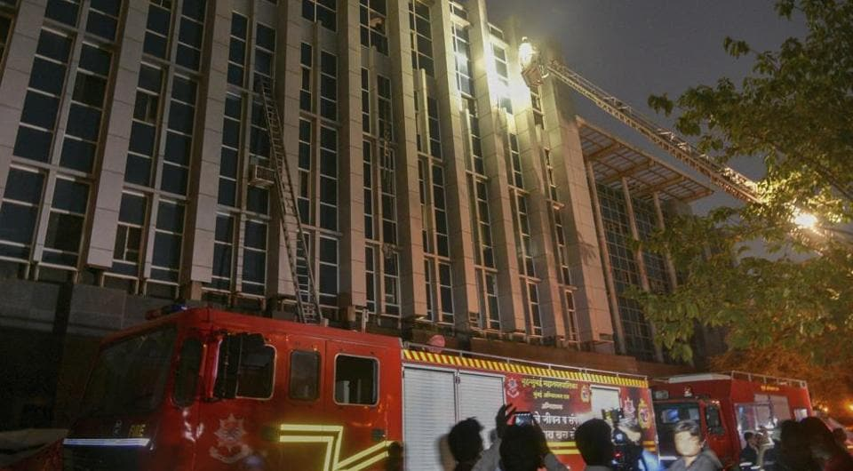 Firefighters conduct rescue after a major fire broke out at ESIC Kamgar Hospital, in Mumbai, Monday, Dec. 17, 2018.