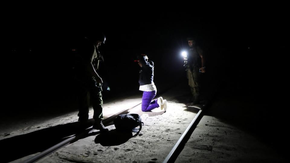 In the pitch black of the moonless Chilean desert night, the Cuban man is hard to spot until he is within yards of the border. Placing a small backpack of clothes on the ground, Yoniel Torres, 31, a father of two, puts his hands up as police approach with flashlights and take him into custody. (Ivan Alvarado / REUTERS)