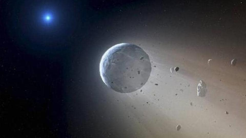 An artist's rendering shows an asteroid slowly disintegrating as it orbits a white dwarf star.