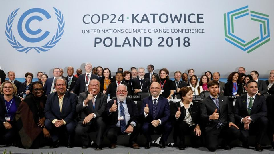 COP24 PresidentMichalKurtyka and Executive Secretary of the UN Framework Convention on Climate Change Patricia Espinosa pose with the heads of delegations after adopting the final agreement during a closing session of the COP24 UN Climate Change Conference 2018, Katowice, Poland, December 15