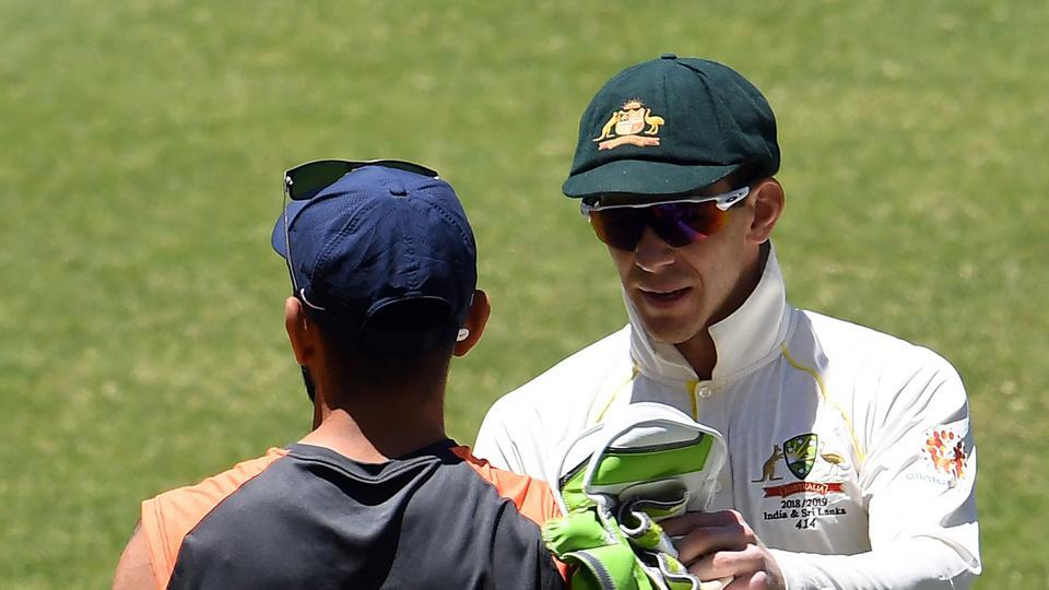 Australia's captain Tim Paine (R) shakes hand with Indian captain Virat Kohli after winning the second Test cricket match between Australia and India in Perth on December 18, 2018
