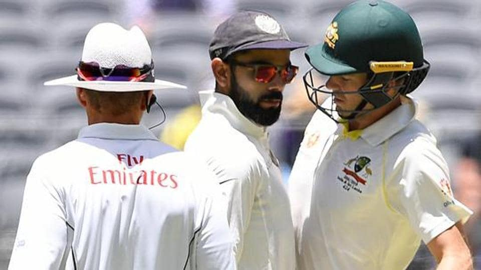 India's captain Virat Kohli (C) and Australia's captain Tim Paine react after Paine ran a single during play on day four of the second test match between Australia and India at Perth Stadium in Perth, Australia, December 17, 2018