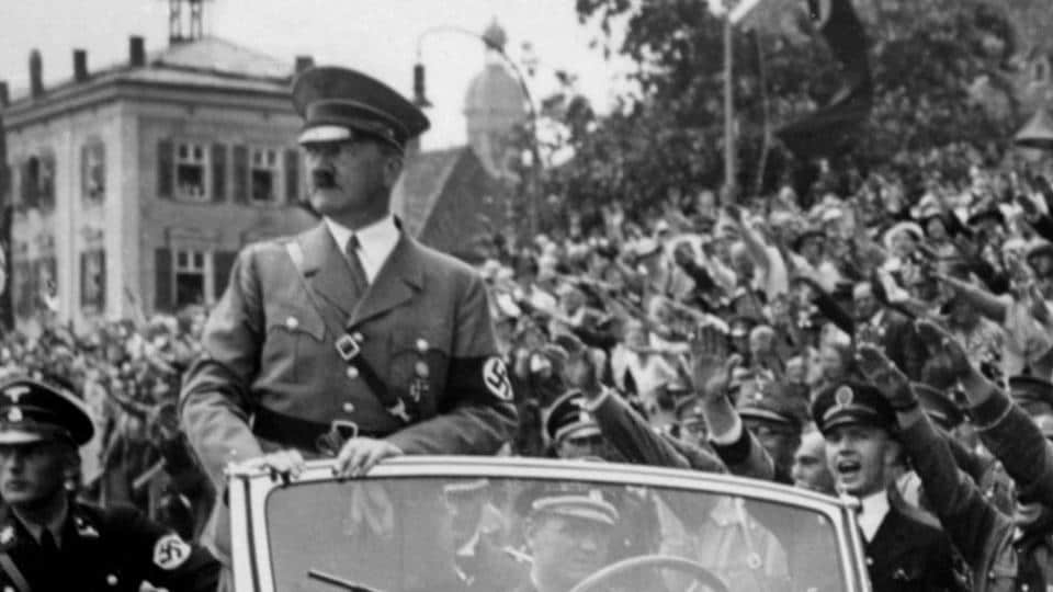 Undated taken from the year 1937 shows German Chancellor Adolf Hitler  standing in a convertible Mercedes in Germany.