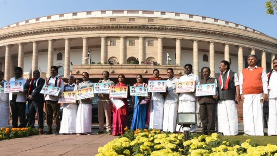 AIADMK MPs staging a protest demonstration demanding to stop construction of Dam at Megadatu across Cauvery River in Parliament house in New Delhi on Wednesday.