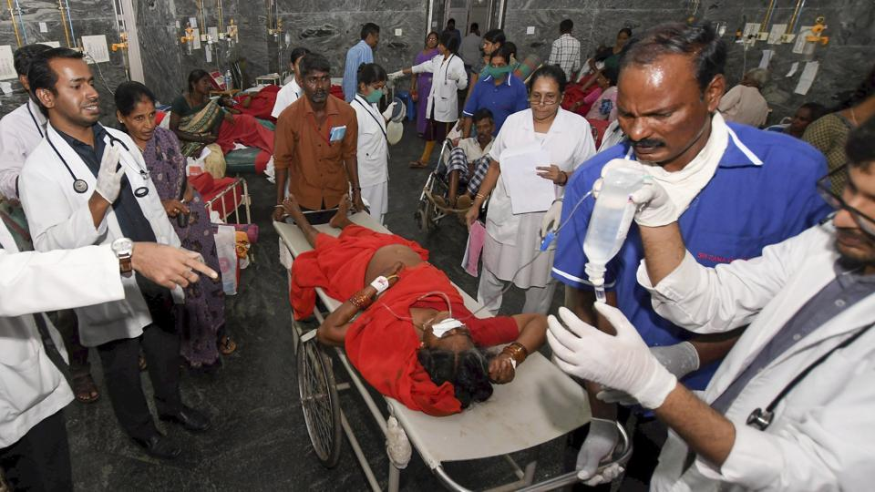 A woman is shifted to a hospital in as she complained of sickness after consuming 'prasad' at Maramma temple in Chamrajanagar district, in Mysuru on December 14, 2018.