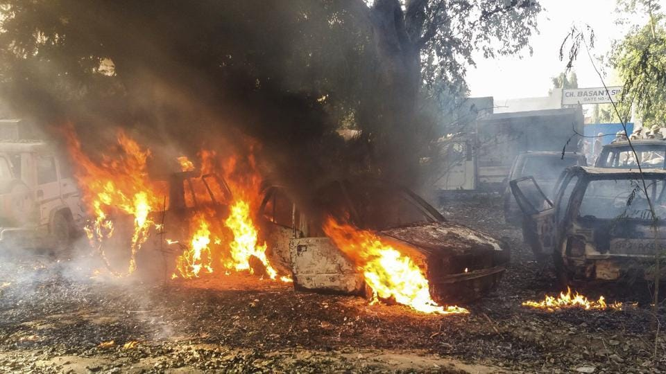 Vehicles set on fire by a mob during a protest over the alleged illegal slaughter of cattle in Bulandshahr on December 3.