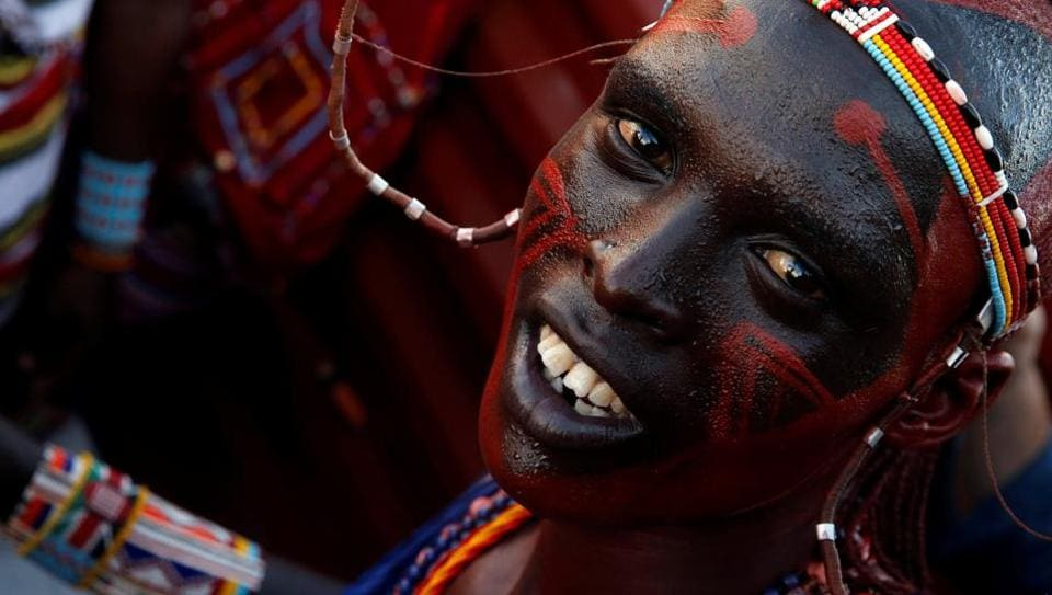 A Maasai Moran athlete from Mbirikani Manyatta rides in a truck as they arrive for the 2018 Maasai Olympics at the Sidai Oleng Wildlife Sanctuary, Kenya. Young Kenyan warriors are no longer pursuing lions to show off their hunting prowess and bravery, they are competing for cash prizes in sports events at the Maasai Olympics instead. (Thomas Mukoya / REUTERS)
