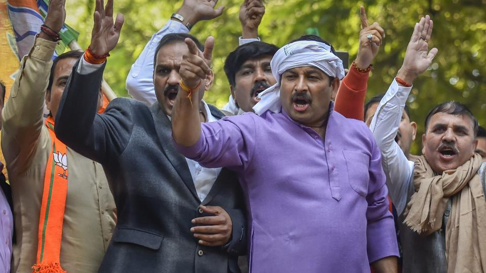 Delhi BJP President Manoj Tiwari with party supporters during a protest against Congress President Rahul Gandhi over the alleged scam in Rafale deal, outside the AICC office in New Delhi, Wednesday, Dec. 19, 2018.