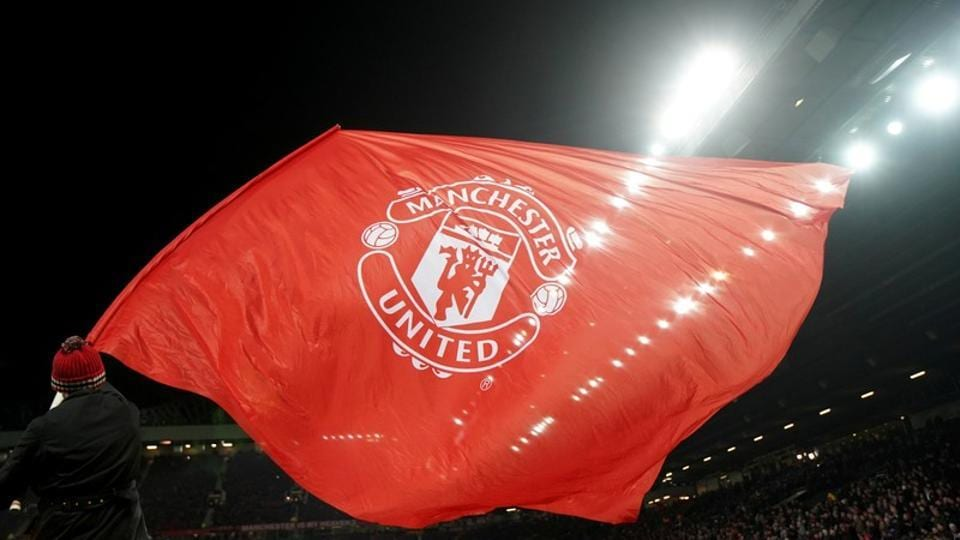 Soccer Football - Champions League Round of 16 Second Leg - Manchester United vs Sevilla - Old Trafford, Manchester, Britain - March 13, 2018 A Manchester United flag is waved before the match