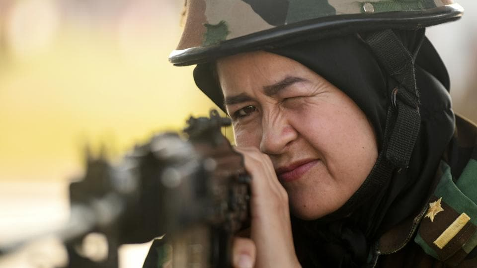 Headscarf clad, an Afghan army cadet shows steely focus as she handles the machine gun with the ease of a professional during a training session at the shooting range of the Officers Training Academy (OTA) in Chennai, Tamil Nadu. (Arun Sankar / AFP)