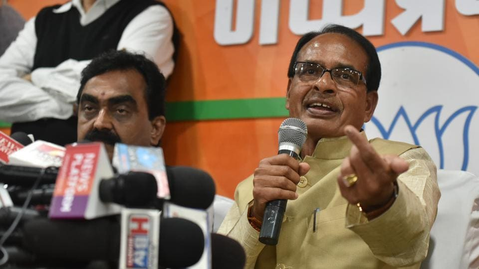 "Former Madhya Pradesh chief minister Shivraj Singh Chouhan, known for his witty remarks and one-liners, displayed his sharp wit once again. Chouhan, addressing party workers who had come to meet him at the chief ministerial residence in Bhopal, reassured them that he wasn't going anywhere and said, ""There is no need to worry about what will happen to them. I, Shivraj Singh Chouhan, am still here. Tiger abhi zinda hai."" (Mujeeb Faruqui / HT File)"