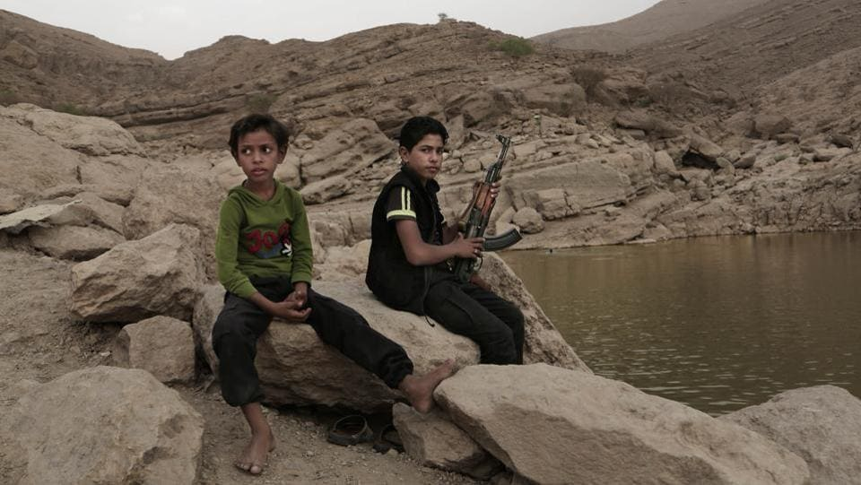 "Experts say child soldiers are ""the firewood"" in the inferno of Yemen's civil war, trained to fight, kill and die on the front lines. Though both sides in the war recruit children, the Houthi rebels rely on them the most. One Houthi military official said 18,00 children had been recruited over the past four years. Most families refuse corroboration for fear of reprisals. (Nariman El-Mofty / AP)"