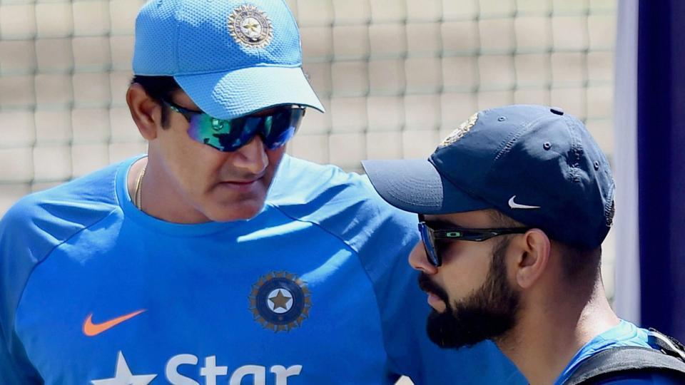 Anil Kumble interacts with skipper Virat Kohli during practice session before the third Test match against Australia.