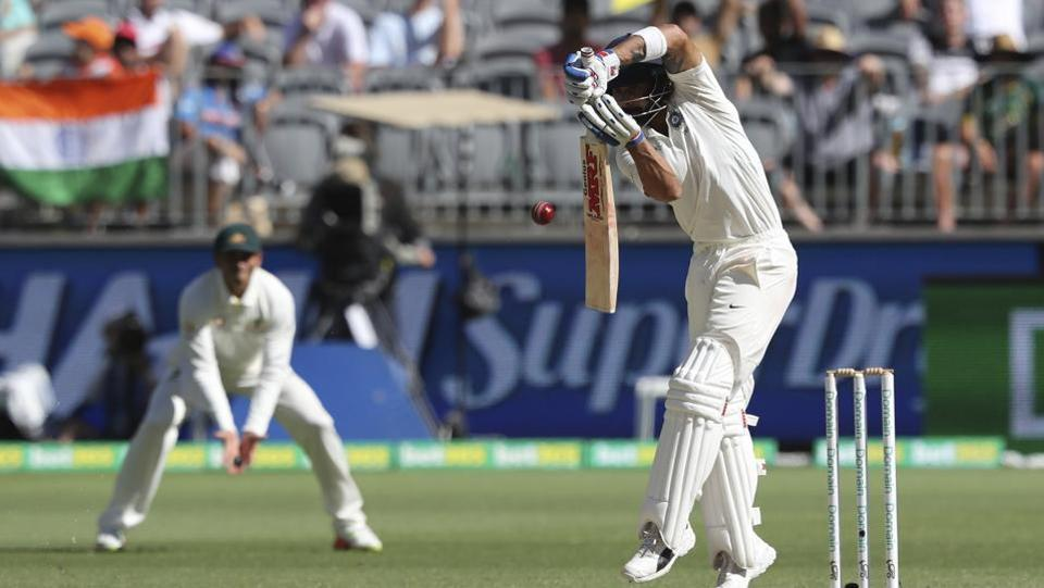 India's Virat Kohli plays a defensive shot during play in the second cricket test between Australia and India in Perth.