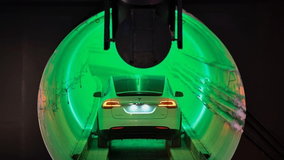 A modified Tesla Model X drives into the tunnel entrance before an unveiling event for the Boring Company Hawthorne test tunnel in Hawthorne, south of Los Angeles, California. (Robyn Beck / Pool / AFP)