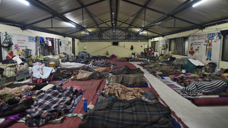 As Delhi's temperature plummets to a bone-chilling 4 degrees Celsius, the city's homeless are sheltering in structures like this one at Sarai Kale Khan, one of the city's 248 night shelters. Of these, 83 are permanent buildings, 115 are porta cabins while 45 are makeshift tents. The capital's Delhi Urban Shelter Improvement Board (DUSIB) is tasked with providing a stay to over 17,000 homeless people. (Burhaan Kinu / HT Photo)