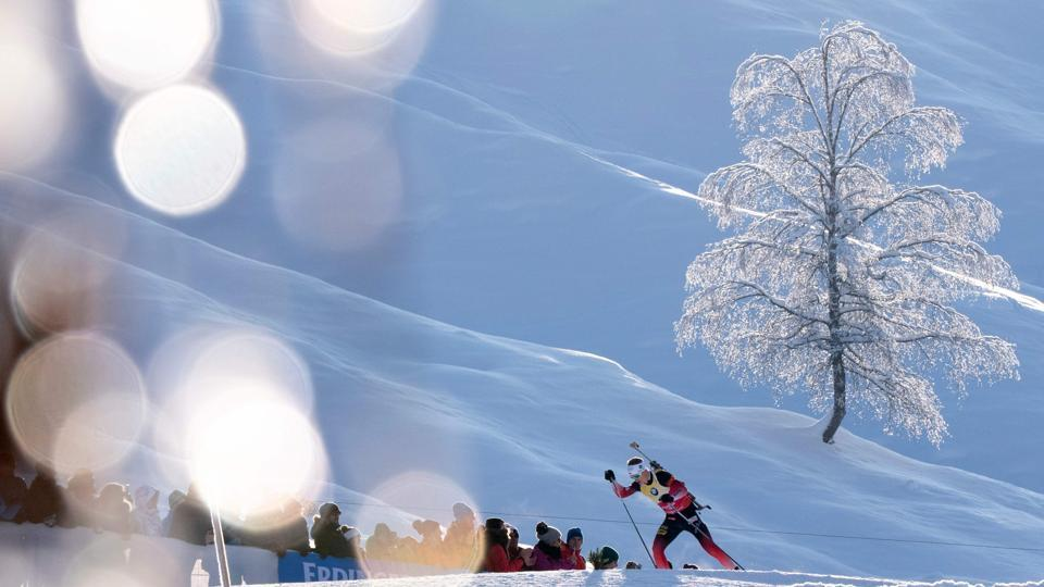 Norway's Johannes Thingnes Boe competes during the men's 12,5 km pursuit event of the IBU Biathlon World Cup in Hochfilzen, Austria. (Joe Klamar / AFP)