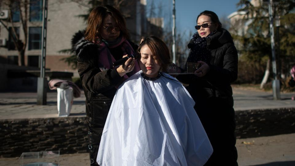 Li Wenzu has her head shaved to protest the detention of her husband and Chinese human rights lawyer Wang Quanzhang, detained during the 709 crackdown, in Beijing, China. (Fred Dufour / AFP)