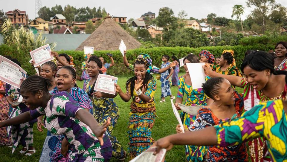 Students sing and dance after receiving their certificates during their graduation party from the City of Joy in Bukavu, Democratic Republic of Congo. (Fredrik Lerneryd / AFP)