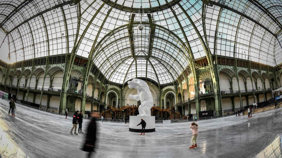 A general view of people on the ice skating rink hosted at the glass-roofed central hall of the Grand Palais in Paris, France. (Stephanie De Sakutin / AFP)
