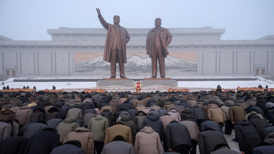 Pyongyang residents bow before the statues of late North Korean leaders Kim Il Sung and Kim Jong Il during National Memorial Day on Mansu Hill in Pyongyang, North Korea. (Kim Won Jin / AFP)
