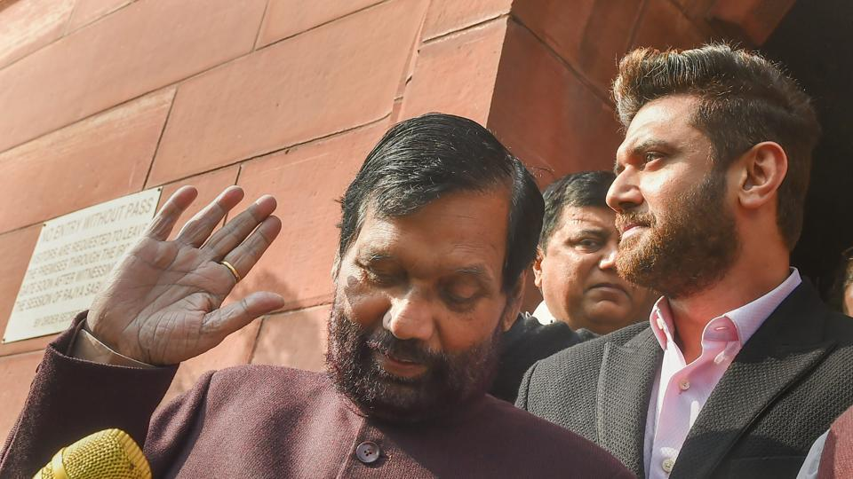Union minister and LJP President Ramvilas Paswan with party MP Chirag Paswan during the Winter Session of Parliament, in New Delhi on December 21.