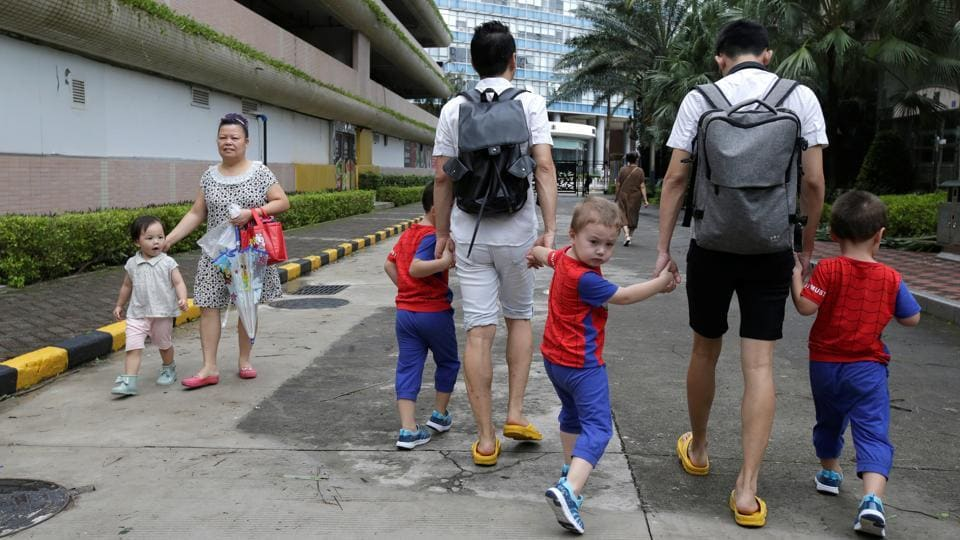 Heads turn when An Hui (L) and Ye Jianbin walk down a street in the Chinese city of Shenzhen with their triplets, who were conceived with help from an egg donor and a surrogate mother. People are mostly curious about their unconventional family, said An, adding that it was not always the case in China where gay couples have long battled conservative Confucian values. (Jason Lee / REUTERS)