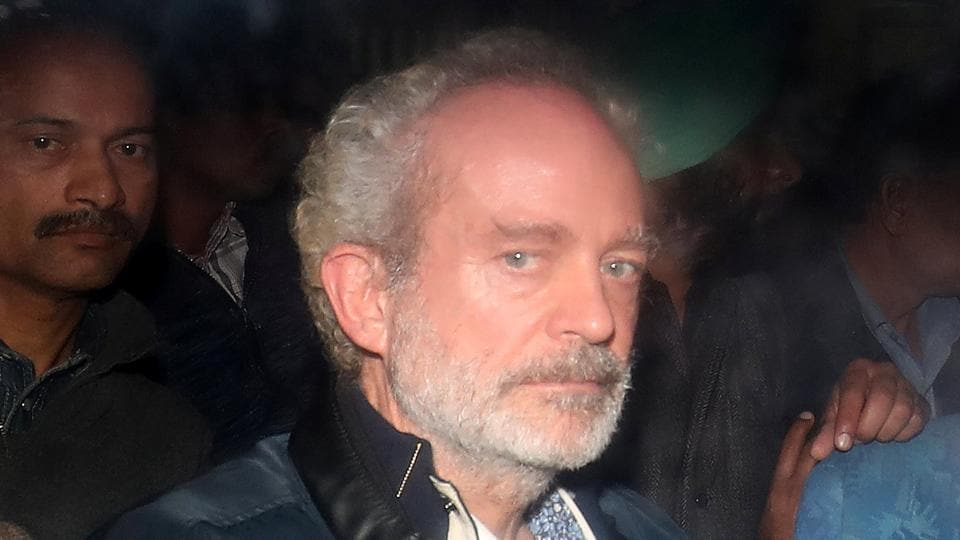 Christian Michel, a key accused and alleged middleman in VVIP chopper case, is pictured inside a police vehicle outside a court in New Delhi on December 5.