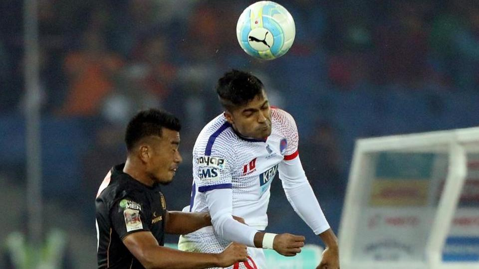 Keisham Reagan Singh of Northeast United FC Pritam Kotal (R) of Delhi Dynamos FC go up for header during match 14 of the Indian Super League between Delhi Dynamos FC and NorthEast United FC.