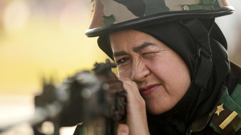 An Afghan woman cadet shoots at a target during a practice session in Chennai, Tamil Nadu during an exchange programme for nineteen Afghan cadets. (Arun Sankar / AFP)