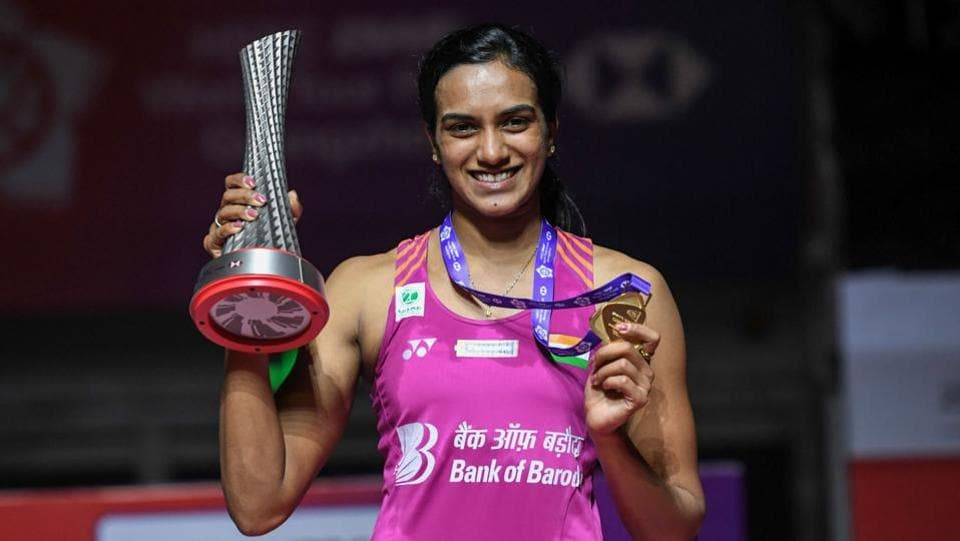 PV Sindhu poses with her trophy after the women's singles final match at the 2018 BWF World Tour Finals badminton competition in Guangzhou in southern China's Guangdong province. (Stringer / AFP)