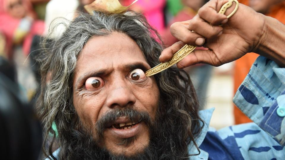 A man goes in to pierce his eye while participating in a 'Rafai Silsila' during the commemoration of the 9th Urs or death anniversary of the Rafai Papa Miyan Sai at the Shah-E-Alam Dargah shrine in Ahmedabad, Gujarat. (Sam Panthaky / AFP)