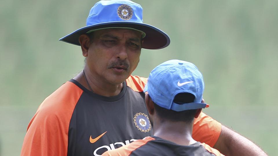 India's Ambati Rayudu, right, listens to team coach Ravi Shastri after batting in the nets.