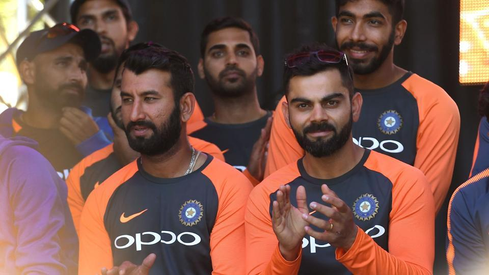 India's captain Virat Kohli (front R) applauds during a meet the fans event in Melbourne on December 23, 2018, ahead of the third cricket Test match against Australia