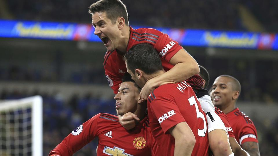 Manchester United midfielder Jesse Lingard, with his teammates celebrates his goal against Cardiff City.