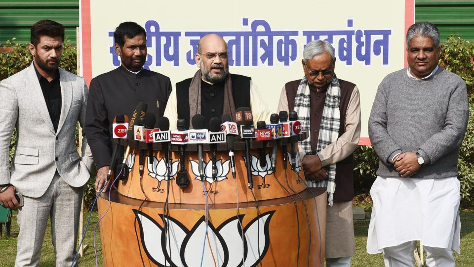 BJP president Amit Shah with Bihar chief minister Nitish Kumar, Union minister Ram Vilas Paswan and his son, Chirag Paswan, at a press conference in New Delhi on Sunday.