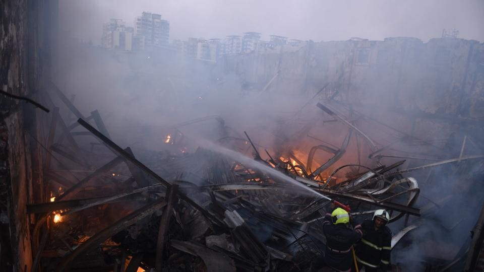 Rescuers have found the bodies of four workers today after Sunday's fire in a clothes factory in Mumbai's Damu Nagar. The workers died after a structure of the factory collapsed due to the fire, which broke out in three shops of Ramlut Garment Company near MIDC bus stop on Sunday. Mumbai Police have arrested the contractor and supervisor of the building. (Pramod Thakur / HT File)