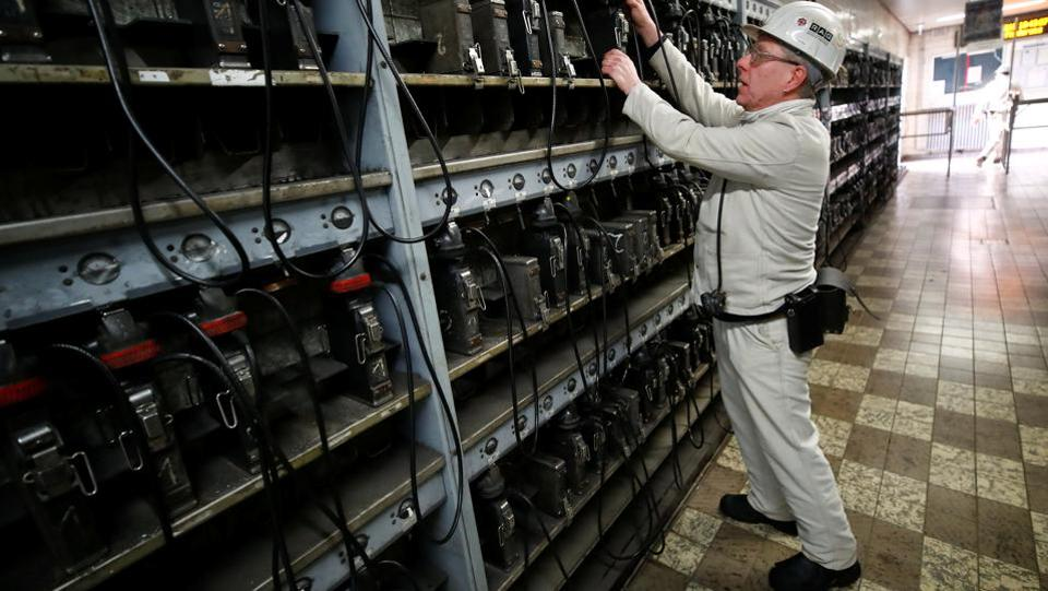 A miner returns his head light onto the charging wall unit. Germany still generates almost two-fifths of its electricity from burning coal, a situation that scientists say can't continue if Germany wants to reduce its greenhouse gas emissions. Lignite is considered even dirtier than black coal but remains relatively cheap to extract, even in Germany. (Wolfgang Rattay / REUTERS)