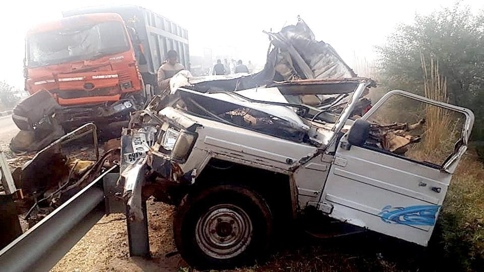 A highway pile-up involving at least 50 vehicles killed eight people, including seven from the same family, in Haryana's Jhajjar early morning due to thick fog. The pile-up occurred after two vehicles collided on Badli Flyover on National Highway-71 and around 10 more piled up behind them due to poor visibility, leading to more injuries. (Manoj Dhaka / HT Photo)