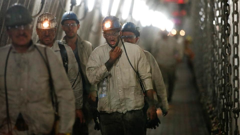 "Miners leave ""shaft 7"", some 1,200 metres below surface, following their shift at the mine. For decades, the mines survived only thanks to generous subsidies. But in 2007, a political decision was made to phase them out, with a promise of early retirement or retraining for their remaining workers. (Wolfgang Rattay / REUTERS)"