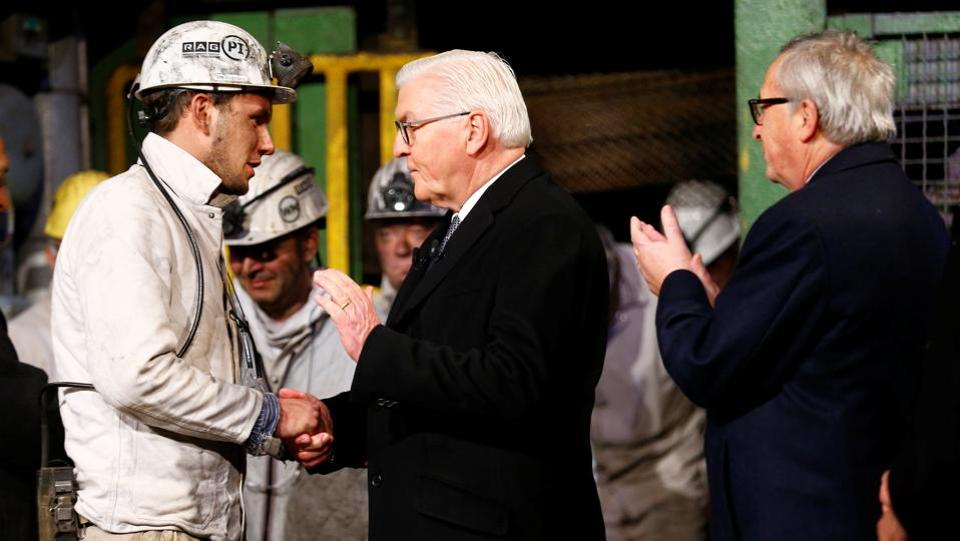 "A miner shakes hands with German President Frank-Walter Steinmeier as European Commission President Jean-Claude Juncker claps during a ceremony marking the end of an industry that laid the foundations for Germany's industrial revolution and its post-war economic recovery. ""A piece of German history is coming to an end here,"" Steinmeier told the miners. (Wolfgang Rattay / REUTERS)"