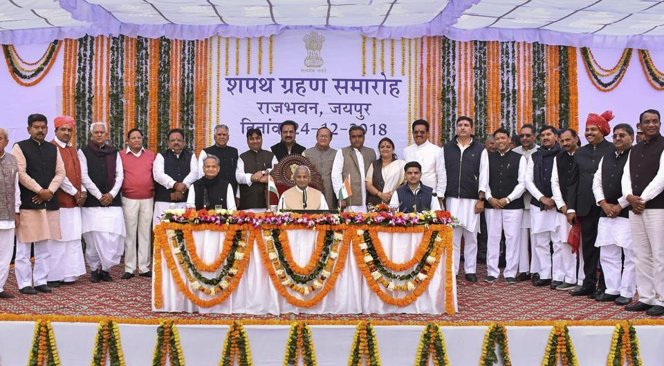 Rajasthan governor Kalyan Singh, chief minister Ashok Gehlot, deputy chief minister Sachin Pilot pose for a photograph with the newly sworn-in cabinet ministers during a ceremony at Raj Bhawan, in Jaipur, Monday, Dec. 24, 2018.