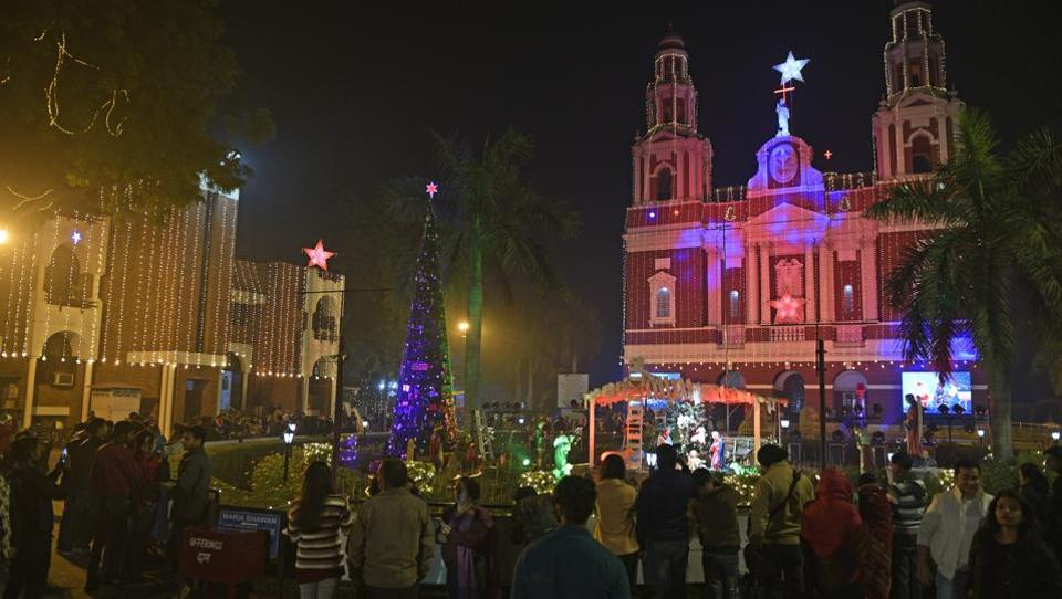 On the eve of Christmas, Sacred Heart Cathedral was decorated with lights, in New Delhi, India. This cathedral is one of the oldest church buildings in the city. Decked up churches in different cities across the country were thronged on Christmas Eve by attendees of the midnight mass.  (Sanchit Khanna / HT Photo)